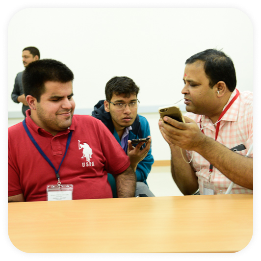 Image of the co-founder - Kartik Sawhney and a blind person accessing I-Stem programs